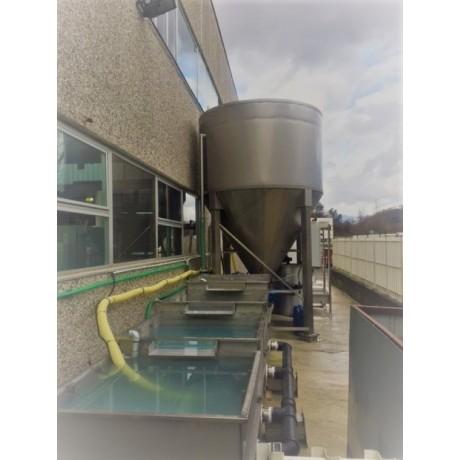 Impianto di decantazione dell'acqua di lavorazione dei centri di lavoro e rettilinee